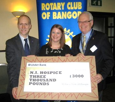 Marcus Cooper and Jenay Doyle receive a cheque from President Robin Mussen