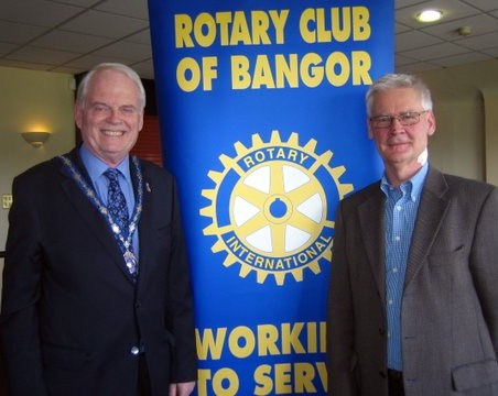 President Robin Mussen welcomes Jim McAnlis to the Club's weekly meeting in April.